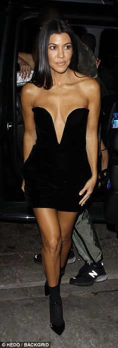 Stylish:Finishing at her upper thigh, Kourtney gave a saucy flash of her slender, toned pins, and elongated them with a pair of pointed court heels