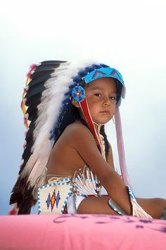 Shoshone boy dressed in traditional regalia and eagle feather warbonnet during the Shoshone Bannock Festival and parade on the Fort Hall Reservation, Idaho