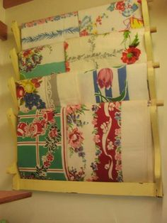 Gun rack for linen display. The old tablecloths were so colorful, very pretty.