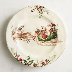 Oh, what fun it is to dine on a special Christmas plate. Our heirloom-worthy Winter's Wonder pattern has all the makings of a family tradition. Crafted of solid ironstone, each piece features a border of holiday greenery and red holly berries.