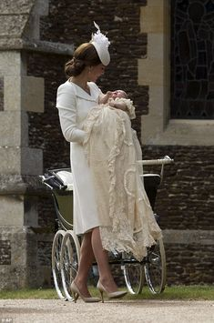Not happy: The baby was dressed in the royal christening gown but looked less than impress...