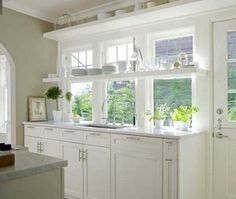 simple shelf above the sink and windows....