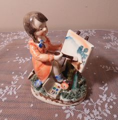 Vintage Figurine by Orion Measures 3 3/4 x 5 Features a lovely little girl painting a nature scene. Nice details. Very sweet home decor accent. Circa 1960s Good condition with no major imperfections as shown. If you have any questions do not hesitate to ask. Thank you for stopping by Isabellas Antiques. I hope you will take a moment to peruse our vast array of antique and vintage treasures all found right here in historical New England. Please look at all images before purchasing. I do m...