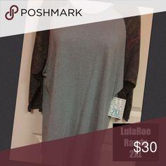 2XL Lularoe Randy Shirt NWT Fits size 22-24 2XL Lularoe Randy Shirt NWT Very cozy! Great fit! This unisex knit shirt resembles a baseball T with its raglan, mid-length sleeves in a contrasting, fabric. 2XL fits women size 22-24 LuLaRoe Tops Tees - Long Sleeve