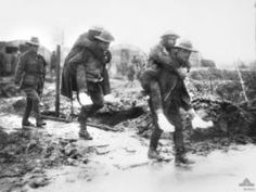 Australian ambulance men at Bernafay carrying victims of trench foot. France WW1