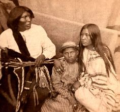 Chief Black Horse with wife Pe-ah-ni and child. Photo taken at Saint Augustine, Florida, 1875. Part of the Lawrence T. Jones III Texas photography collection. Series 7: Stereographs. - No information on the chief's tribe.