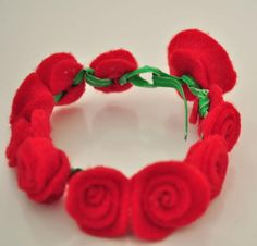 Rose Red Felt Bracelet: The ruby red hue of this rose bracelet makes it perfect for Valentine's Day; but, it could also be a precious gift for Mother's Day or Christmas.