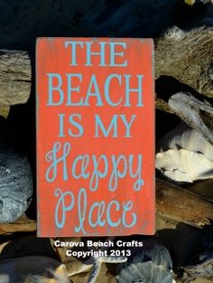 """Original beach décor sign.  The Beach Is My Happy Place  Hand painted rustic wood sign.  It is distressed and painted a rustic coral color with aqua blue  lettering.    Size:  12"""" x 7""""  Thank you for visiting our shop.  We are glad you are here.  If you have any questions please let us know."""