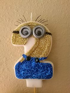 Check out this item in my Etsy shop https://www.etsy.com/listing/183346428/cutest-minion-blinged-out-birthday