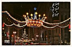 How about a little Kansas City Christmas history? These giant crowns graced the Petticoat Lane district for nearly a decade. They were eventually switched out for smaller decorations. Where can you see them today? Find out >>> Christmas History, Christmas Past, All Things Christmas, Vintage Christmas, Christmas Lights, Victorian Christmas, Christmas Photos, Winter Christmas, Kansas City Downtown