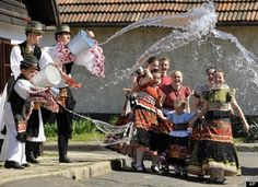 Easter Celebrations Around The World (PHOTOS)   Hungary, pouring buckets of water on Matyo girls