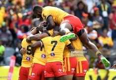David Mead of Papua New Guinea is congratulated by team mates after scoring a try during the Rugby League World Cup match between Papua New Guinea and Wales at Oil Search National Football Stadium on October 28, 2017 in Port Moresby, Papua New Guinea.