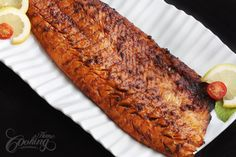 Grilled Salmon  1/2 pounds salmon fillet  4 garlic cloves, minced  1/3 cup soy sauce  1/3 cup brown sugar  2 tbsp fresh lemon juice  1/4 cup olive oil  salt and freshly ground black pepper