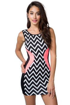 Show off that figure in this eye catching bodycon dress! Zigzag print in the front and a back. Solid contour panels at the sides. Round neck. Scoop back. Sleeveless. Finished short hem. Textured and scuba knit. Unlined.