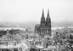 Cologne Cathedral stands intact amidst the destruction caused by Allied air raids 9 March 1945.