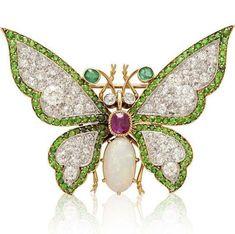 Butterfly brooch. ca. 1890. Gold, platinum, ruby, diamond and demantoid garnet. via @Sothebys