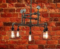 Vintage, Industrial, Unique, Steampunk, 5-Light Steel and Cast Iron Pendant with cages, gauges and brass valve. Looks great with Edison Bulbs (available separately). o All electrical components are UL