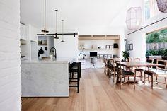 Open kitchen and dining room with full-length glass doors leading to the garden. #remodelista #bondibeach #modern #barn #australia #interiordesign