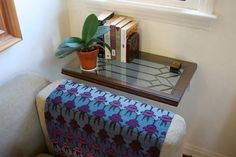 What a cool idea to use a thrift-store-found window as a side table! No legs, and brings that beautiful look into the house without having to hang it in the window.