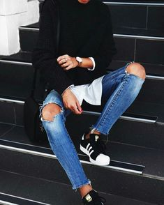 Black sweater, white shirt, broken jeans, adidas superstar black and white sneakers.