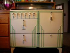 Art Deco design found its way into kitchen appliances we now call vintage.  This is a 1932 Magic Chef stove posted by Don Ree.  His grandmother cooked on it and it still works.  The paint is original.  Notice the pulls for the doors/drawers.  It is a beauty