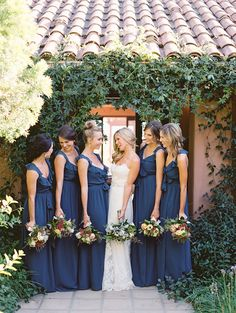 Lovely Dark Blue Bridesmaids Dresses-- from Joanna August || See the wedding on SMP:  http://www.StyleMePretty.com/2014/02/19/classic-santa-barbara-wedding-at-apple-creek-ranch/ Photography: Lane Dittoe