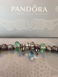 fd7e2ce57 My faceted beauty, ice blue Murano glass dangle charm and clear teal flower  Murano glass charms in my Pandora flower bracelet 💗 by Nicole.