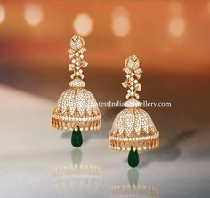 Enhance your charisma with these sparkling diamond jhumka earrings from Kirtilals. The extravagant diamond jhumkas in delicate floral design with a touch of emerald drops Jewelry Design Earrings, Gold Earrings Designs, Gold Jewellery Design, Designer Earrings, Gold Designs, Jhumka Designs, Gold Jewelry, Diamond Earrings Indian, Diamond Jhumkas