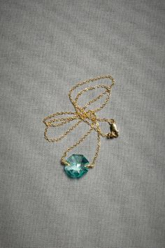 """Barely touched by wire-wrapped prongs, Dana Kellin's aqua crystal seems to defy gravity. Lobster clasp. 14k gold fill, crystal. 16.75""""L. Handmade in USA."""