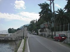 Located Near Hafenhotel Meereszeiten, Corfu or Kerkyra (/kɔːrˈfuː, -fjuː/; Corfu Town, Corfu Island, Places In Greece, Corfu Greece, Find Hotels, Tourism, Places To Visit, Greek, Sidewalk