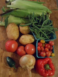 August 20, 2014: six ears of corn, some potatoes, green beans, tomatoes big and small, a big bell pepper that I will give away, a yellow onion, and a jalapeno. At the market I got the first Italian plums of the season, dirt-cheap leeks, and millions of peaches.