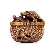 A Wood Netsuke Signed Tadakazu, Edo Period (18th-19th century) Of turtles in a bamboo basket 4cm. wide