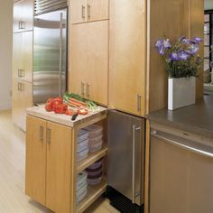 Hide additional work surface in your cabinetry with false cabinet fronts.