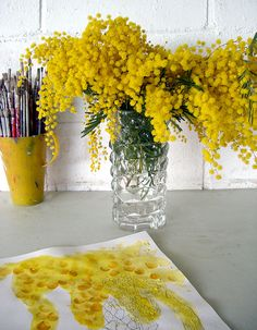 Acacia is a bright beautiful yellow. Would be great in high centerpieces!
