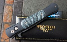 """USTOM Protech / AIK """" LARGE DON"""" AUTO with Fossil Brain Coral Handles and Special Black Blade."""
