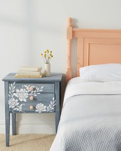 Just because it sits beside your bed, there's no reason that your nightstand needs to put you to sleep. Jazz up a boring bedside table by adding a vintage effect and some stenciled floral accents to really make the piece pop.