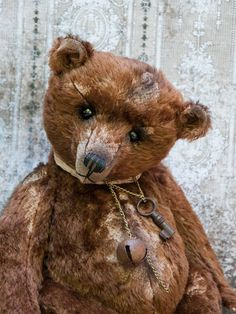 I love this old tattered bear.