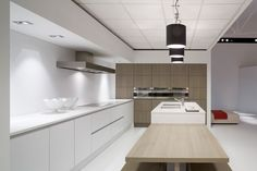 Abit of wood in the kitchen gives a soft contrast to the stone benches & hard floors, also nice to have pendants to create a focal point in kitchen
