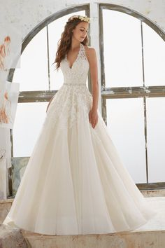 Romantic wedding dress idea - A-line dress with halter neckline and lace details. Style 5513 by @morileewedding.
