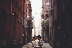 @Somi Ahmadian. With a kiss and Ryan holding Mistletoe. I like the framing.