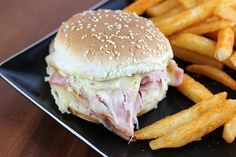 Hot ham and swiss  Ingredients: ¼ cup butter (or margarine) ¼ cup mayonnaise 3 tablespoons creole mustard 1 tablespoon grated onion 2 teaspoons poppy seeds 8 hamburger buns (split) 1 (6 ounce) package Swiss cheese 1lb thinly sliced ham