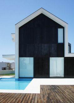 "Rui Ventura / black and white modern take on the typical ""house shape"""