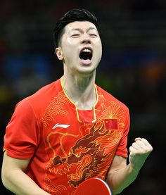 China's Ma Long celebrates after defeating compatriot Zhang Jike in the men's singles table tennis gold medal match at the Rio de Janeiro Olympics on. Table Tennis Player, Tennis Players, Tennis Table, Ma Long, Chinese Table, 2016 Pictures, Olympic Champion, Racquet Sports, Play Tennis