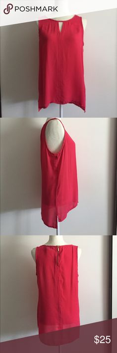 Express sleeveless sheer coral top w/ peek hole Super comfy yet sexy Express sleeveless sheer coral top w/ peek hole. In good condition, dry cleaned. Features zipper in back. Express Tops Blouses