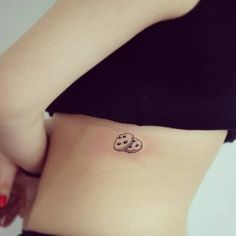 Cookie tattoo on the left side.