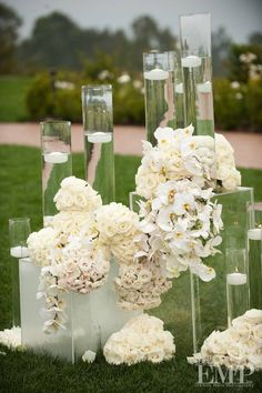 Love the flowers mounded at the base of the vases