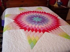 Candy colored Lone Star quilt.