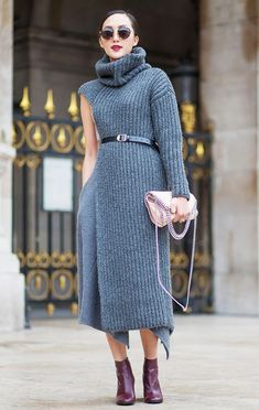 Chriselle Lim wears a long ribbed turtleneck sweater, wool skirt, flap bag, ankle boots, and round sunglasses