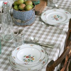 your grey/blue and white check tablecloth, blue ticking/red plaid edge casserole cover, stetson flowered plates