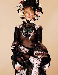 Normally we associate floral style with the spring season, but for its December 2015 issue, Harper's Bazaar Japan embraces the winter floral trend. Photographed by Francois Nars, model Daria Strokous tries on beautiful blooms ranging from sheer dresses and blouses to intricate headpieces. Posing against patterned backdrops, the floral prints are amplified even more. Related: …